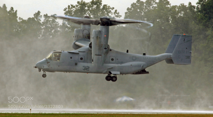 MV-22B landing in a heavy downpour and generating an awesome vortex.