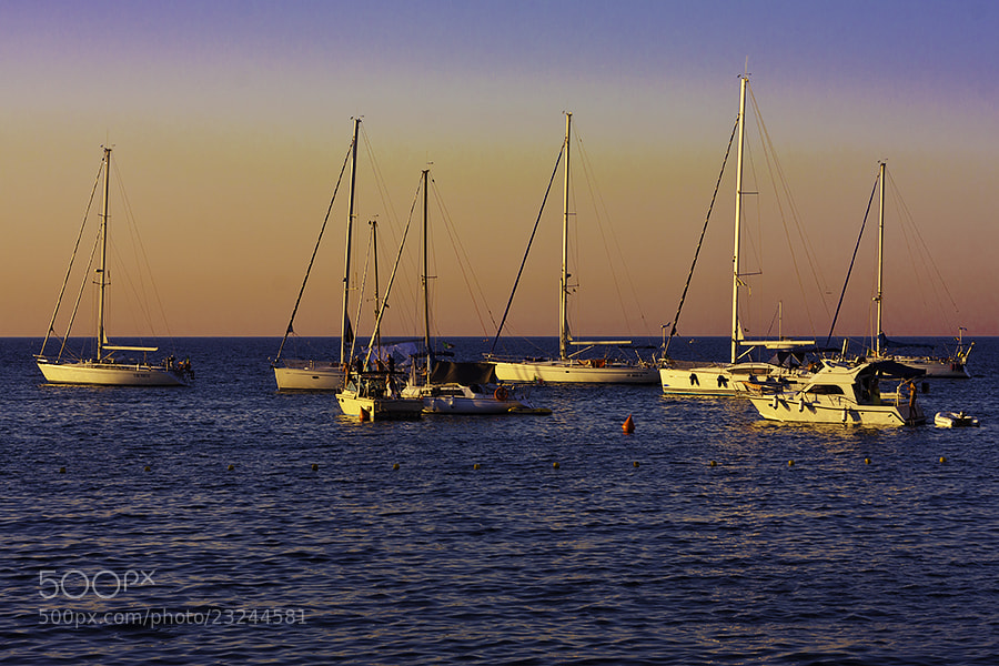 Photograph Swinging at Sunset by Davide Rindori on 500px