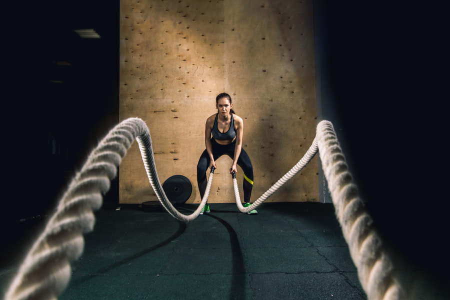 battling ropes girl at gym workout exercise fitted body by Ufa Bizphoto on 500px.com