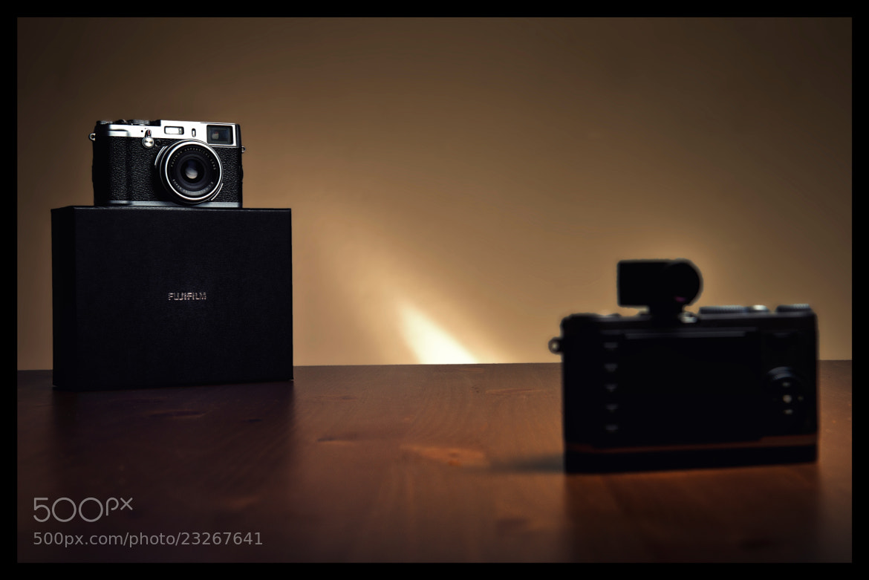 Photograph Fuji X100 vs Leica X1 by Emil  on 500px