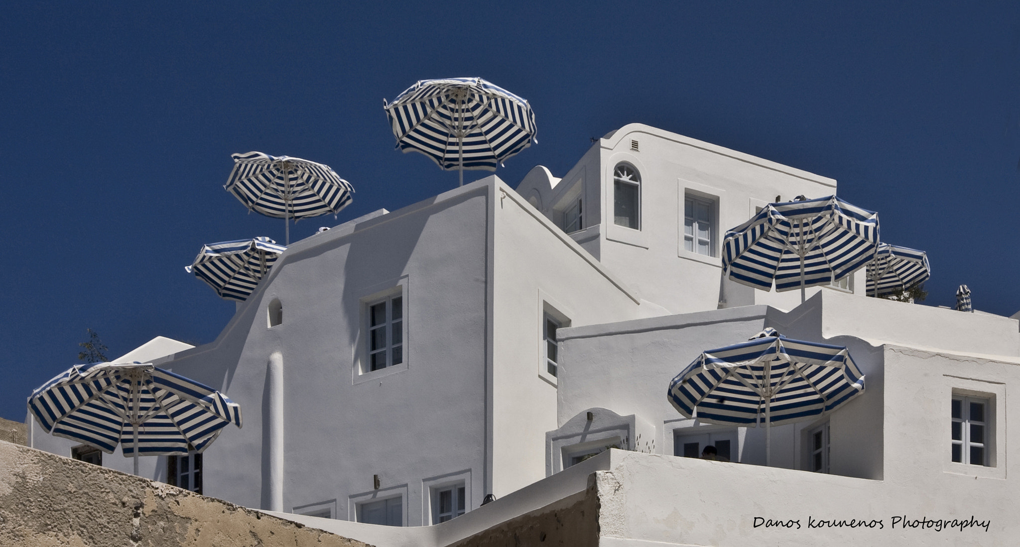 Photograph Umbrellas on the terraces by Damianos Kounenis on 500px