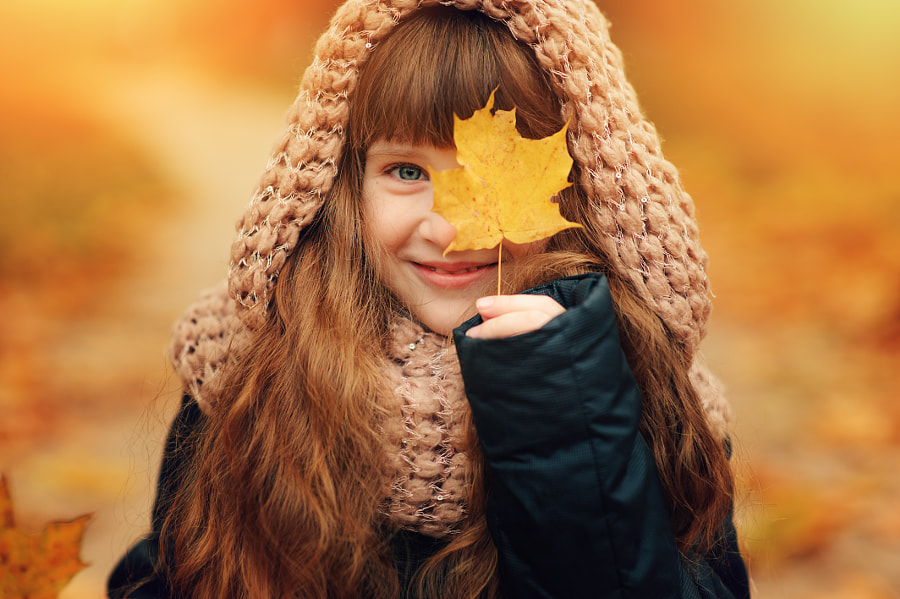 autumn outdoor portrait of beautiful happy child girl walking in park or forest in warm knitted... by Maria Kovalevskaya on 500px.com