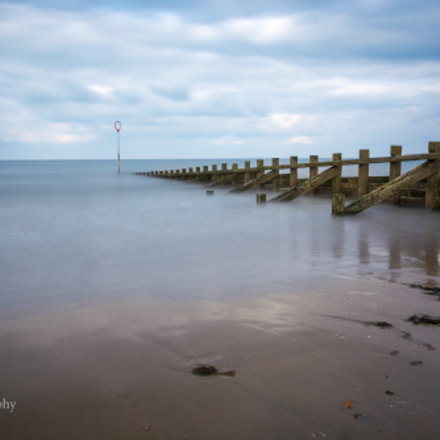Long exposure at Portobello beach with groynes and a calm sea