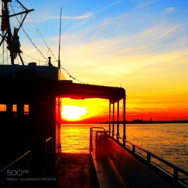 Photograph Slow Boat to Sunset by Dina Dimopoulos on 500px