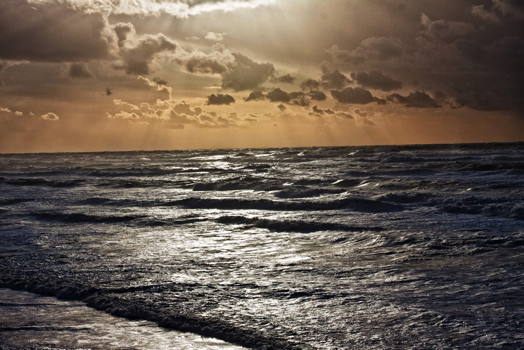 Photograph Sun on stormy seas by David Eger on 500px