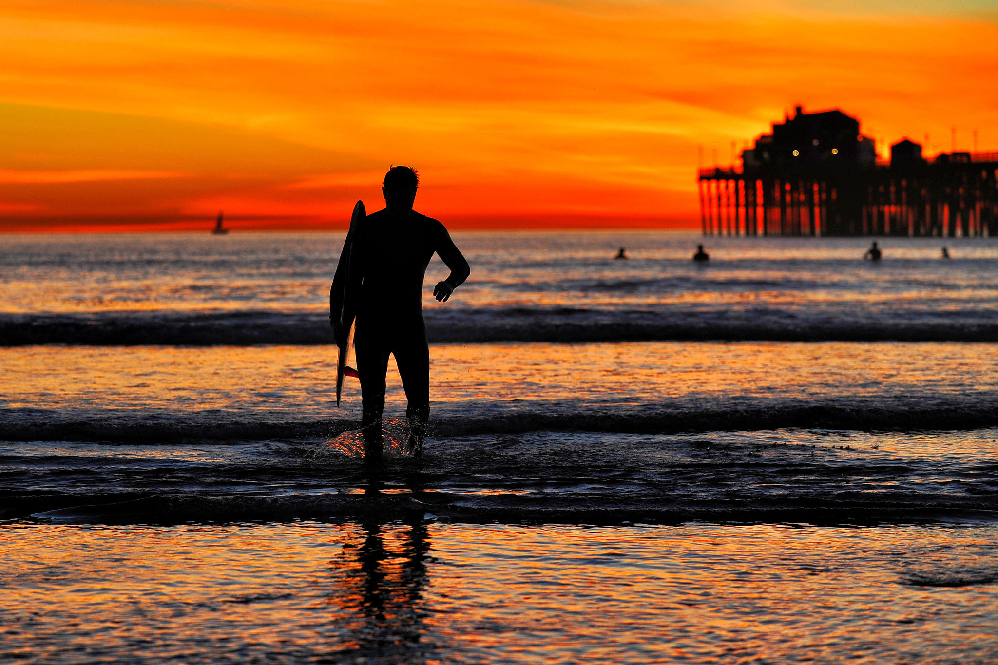 Photograph A Surfer at Sunset in Oceanside - January 18, 2013 by Rich Cruse on 500px