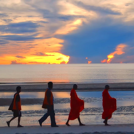 Monk's walking in beautiful sunrise clouds
