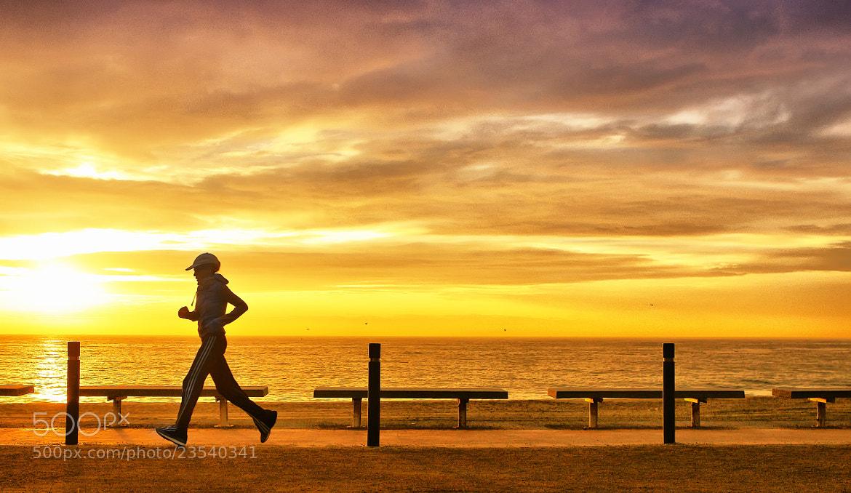 Photograph sunrise runner girl by Marc Serarols on 500px