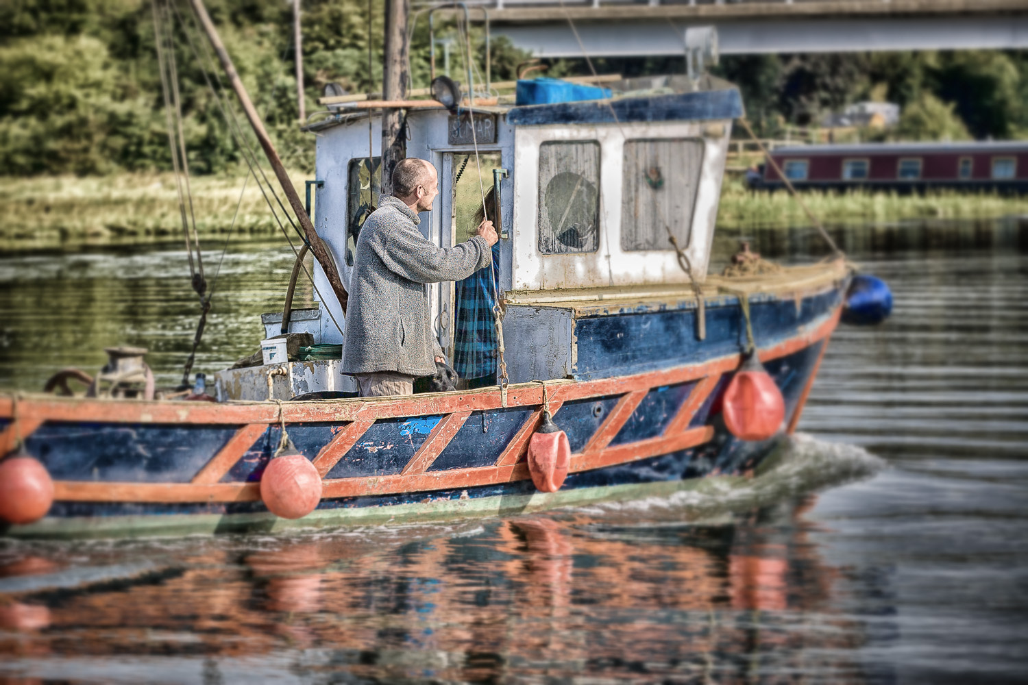 Photograph Working man on the river by Paul Todd on 500px