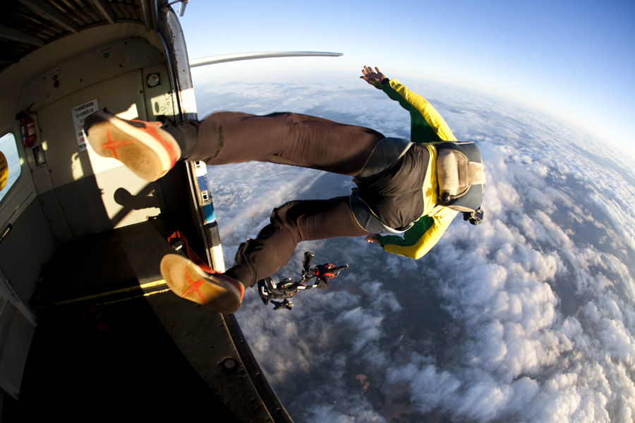 Skydiver exiting the airplane by Rodrigo Kristensen on 500px.com