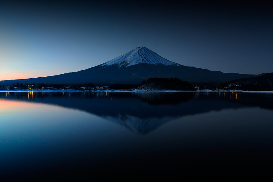 """""""Mt.Fuji in early morning""""; I took this image at  6:18 AM before sunrise.  At that time the surface of lake Kawaguchiko was windless and silent .  At the same time an inverted image of Mt.Fuji reflected in the lake appeared."""