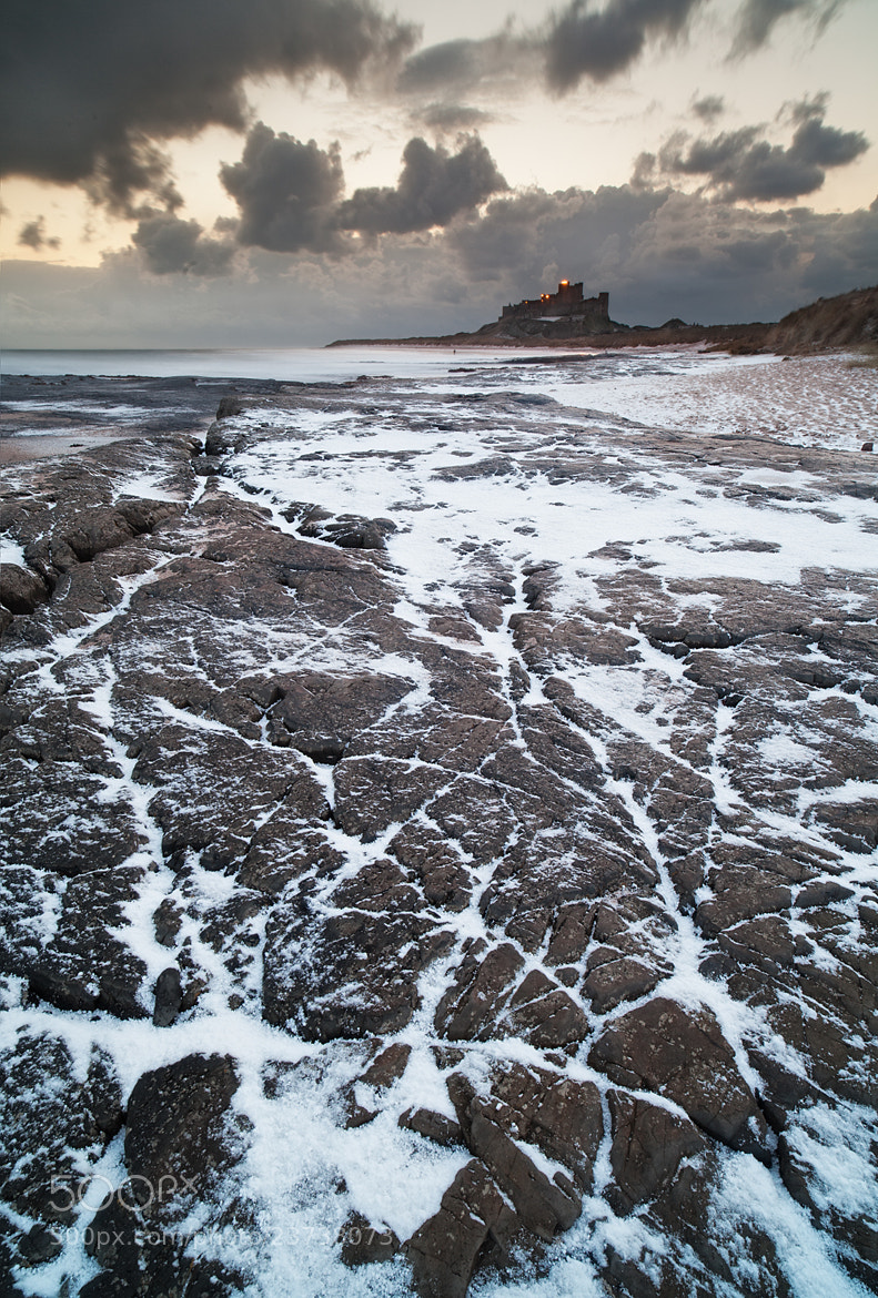 Photograph  Bamburgh Castle in Winter by Daniel Hannabuss on 500px