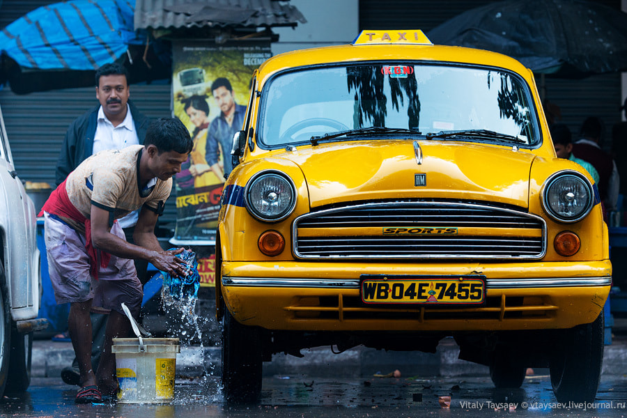 Photograph Taxi cab washing in India by Vitaly Taysaev on 500px
