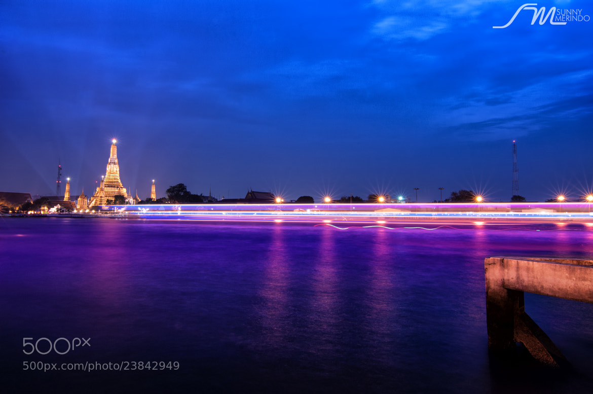 Photograph Chao Phraya River and the famous Wat Arun in Bangkok  by Sunny Merindo on 500px