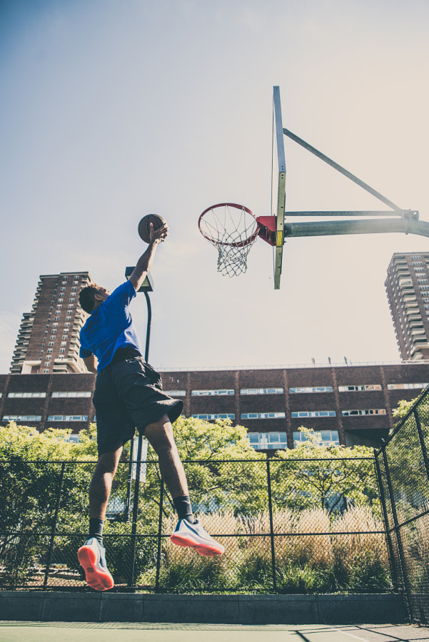 Basketball player playing outdoors by fabio formaggio on 500px.com