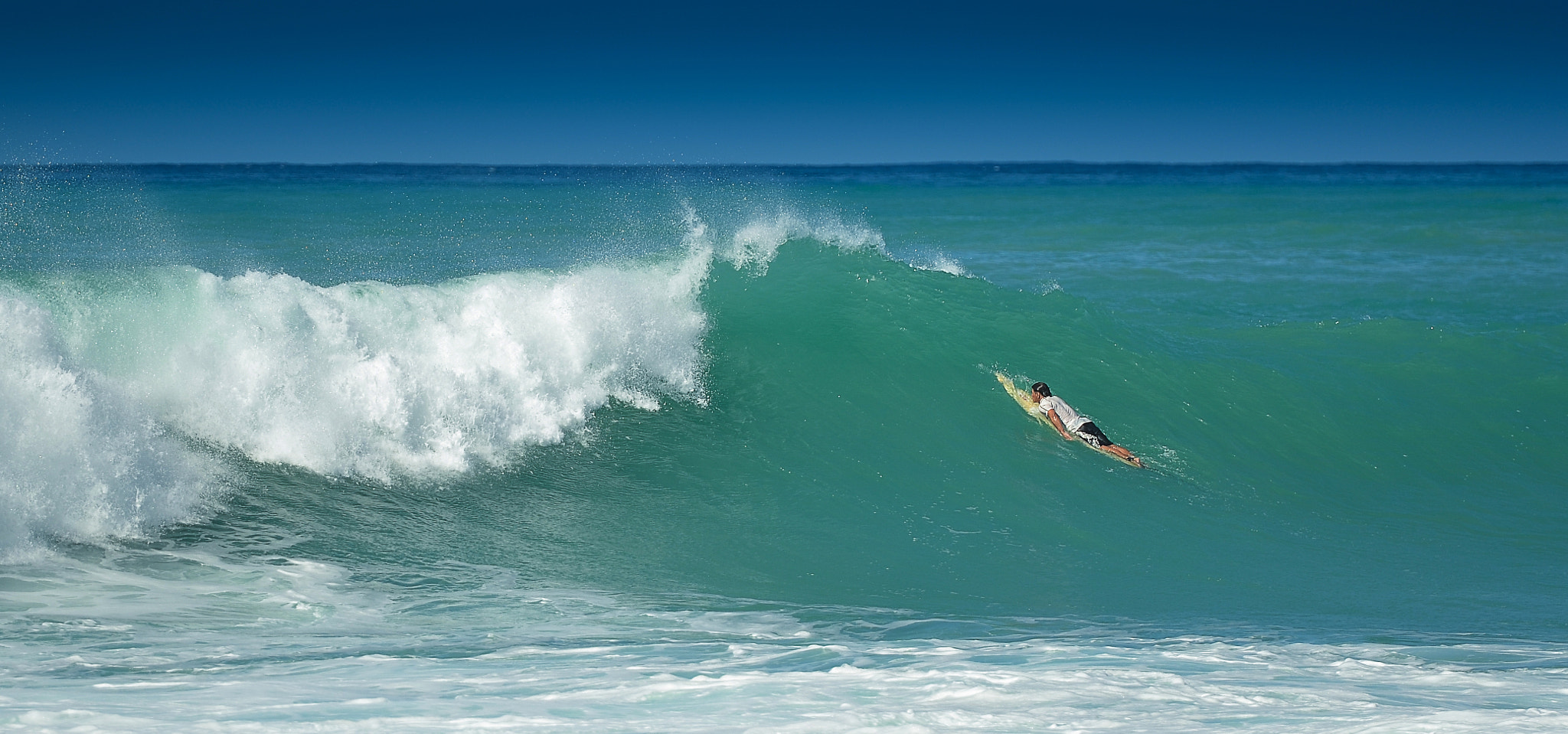 Photograph Surfing in Hawaii by Tin Lung Chao on 500px
