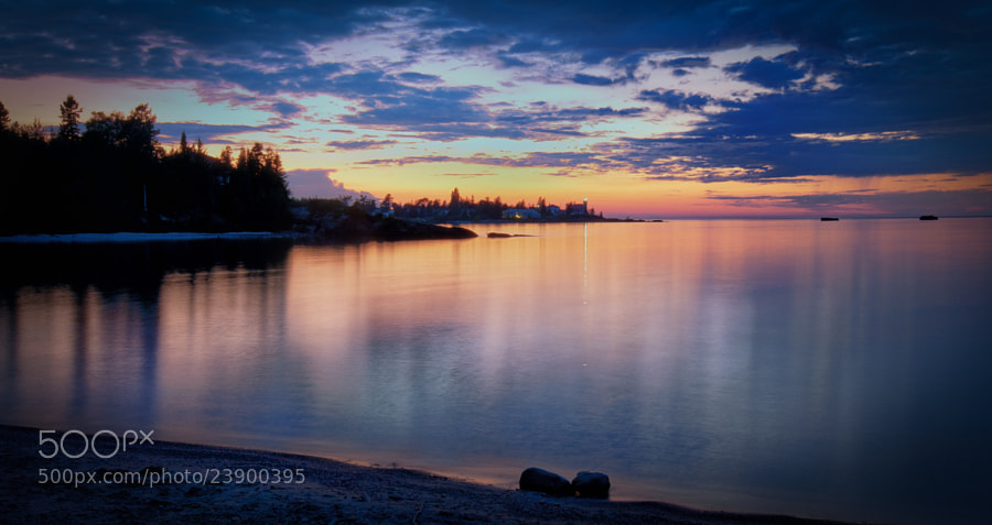 Eagle Harbor, Michigan. The pinpoint of light on the horizon and the reflection on the water is from the Eagle Harbor lighthouse.