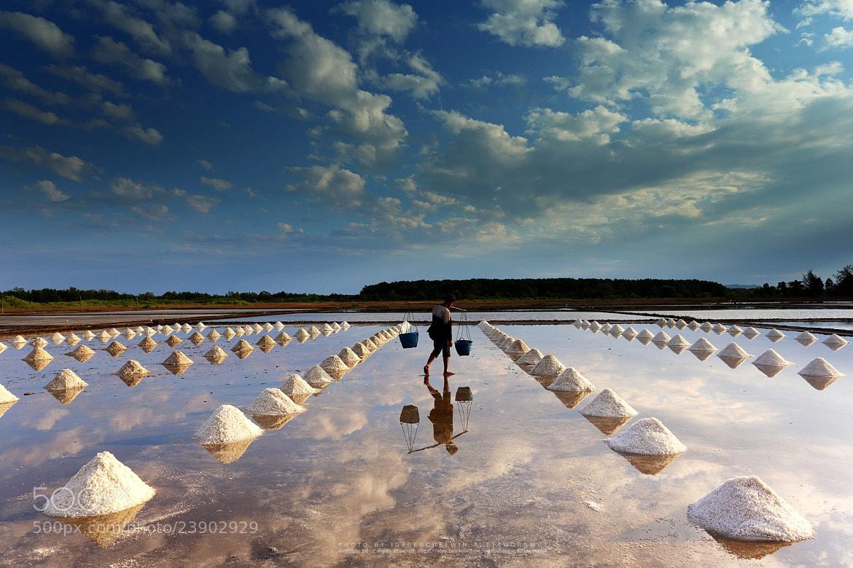 Photograph Worker in salt farm of eastern, Thailand by isarescheewin on 500px