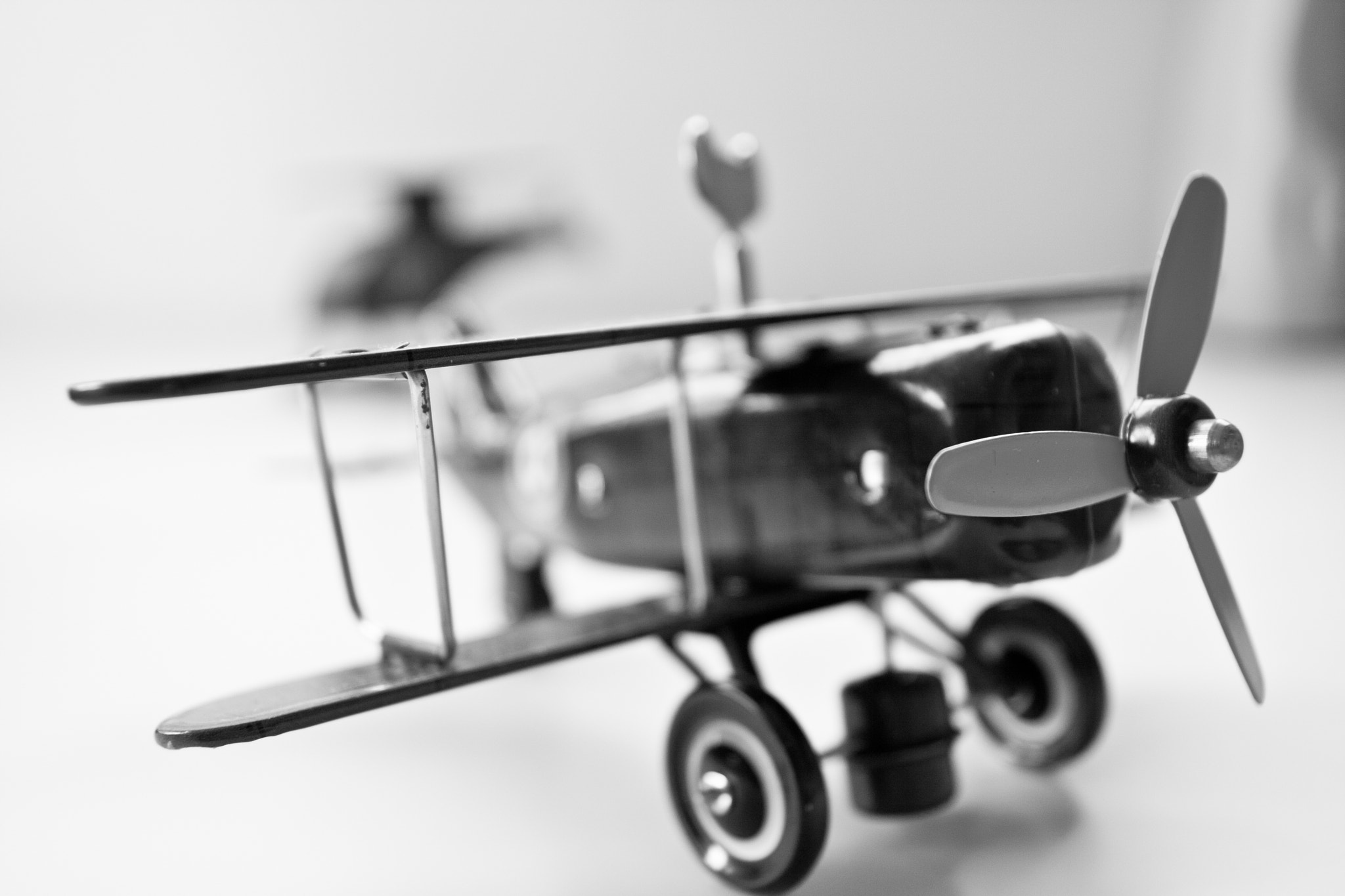 Photograph Toy metal plane by Miguel Aparicio on 500px