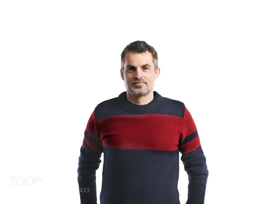 Mature hipster man in woolen sweater. Studio shot,…