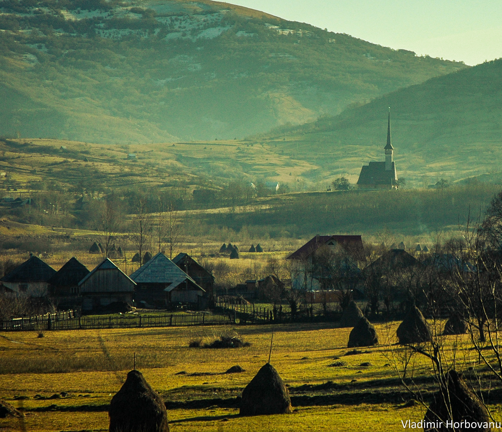 Photograph Wooden church watching over the village by Vlad  on 500px