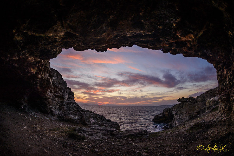 Sunrise in coastline cave