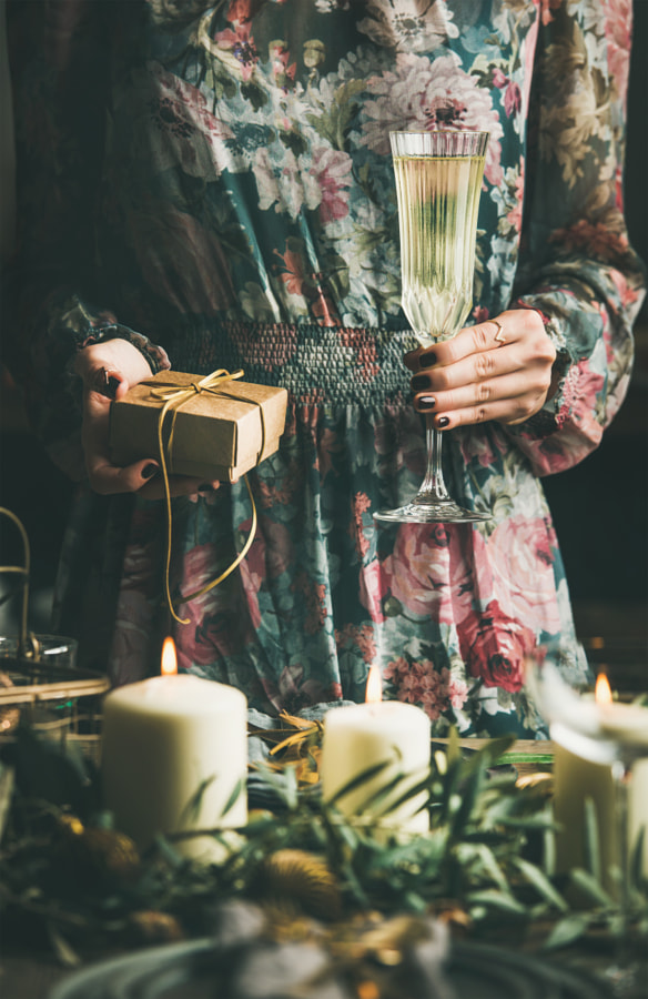 Woman holding glass of champaigne and gift box, Christmas eve by Anna Ivanova on 500px.com