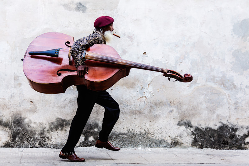 Photograph Cuban Man with Large Moustache Walking with Double Bass by Jeremy Woodhouse on 500px