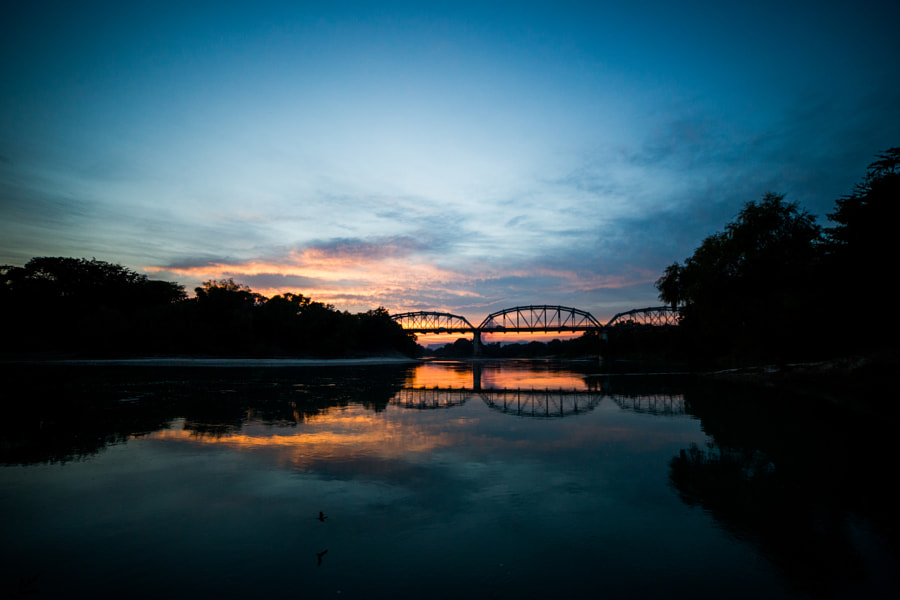 Sunset over (and under) Tampoán bridge and a watering bat. by alberto alcocer on 500px.com