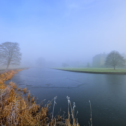 Broughton Castle moat in fog