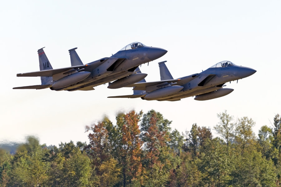 A pair of F-15 Eagles makes a low formation pass.