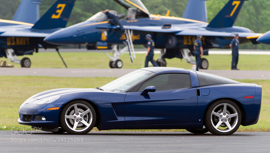 This special Corvette is owned by the Crew Chief for the USN Blue Angels. It is painted in Blue Angel blue color and has a Blue Angel yellow arrow, matching the arrow on the bottom of the F/A-18 jets, painted on the hood.