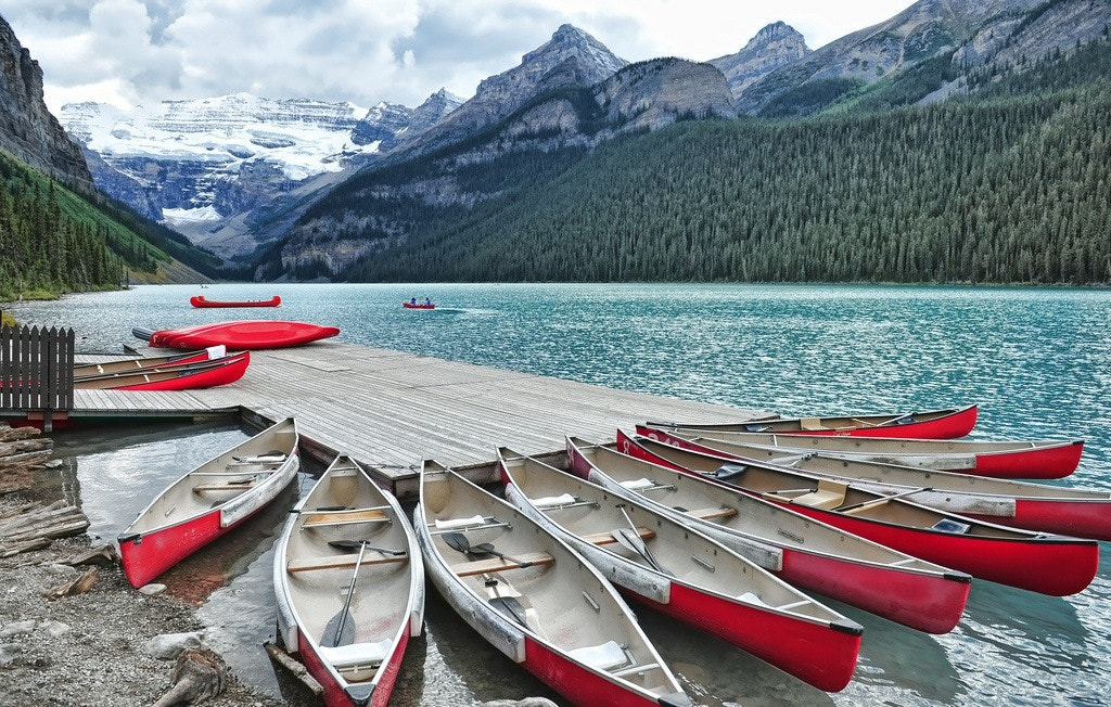 Photograph Red Canoe Escape by Jeff Clow on 500px