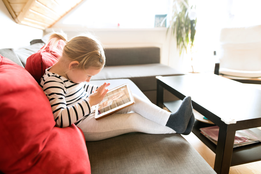 Little girl at home with tablet, video chatting with her mother. by Jozef Polc on 500px.com