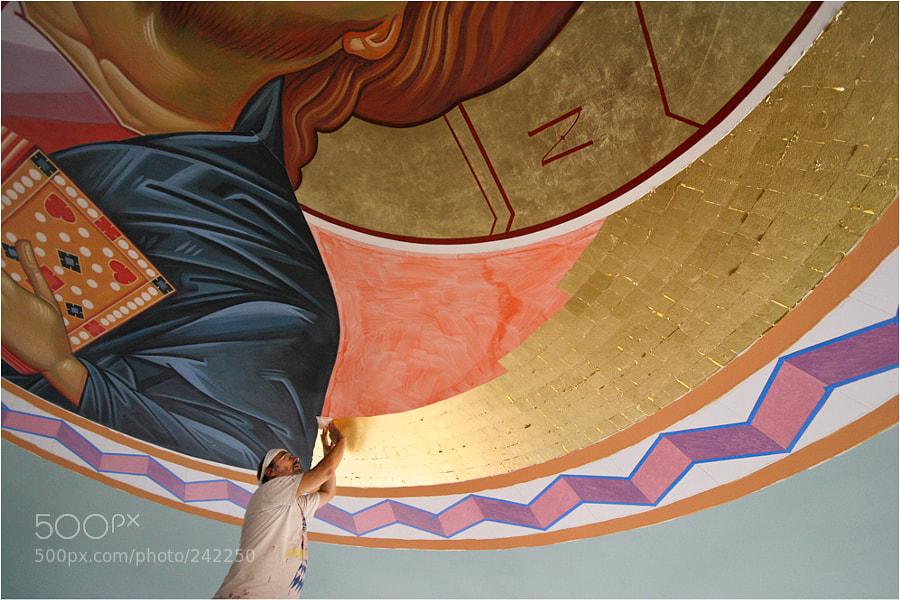 "My friend Volodya Pronkin applying the Gold leafs on the background of the icon"" Pantocrator""  or ""Lord Almighty""."