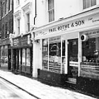Outside Paul Rothe & Son in a snowy day in London.