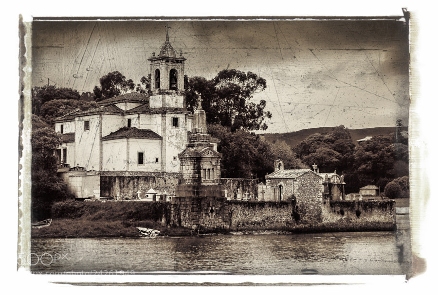 A beautiful and old church in the North of Spain with a small cemetery which extends into the sea