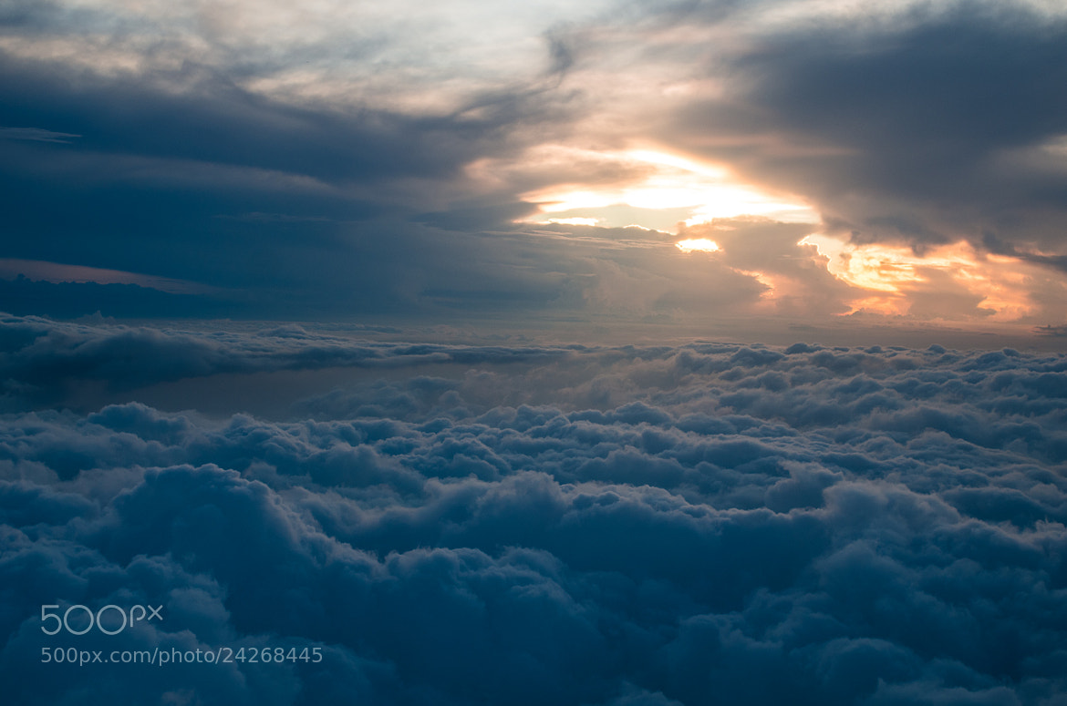 Photograph Flying over the clouds in the sunset by hoq on 500px