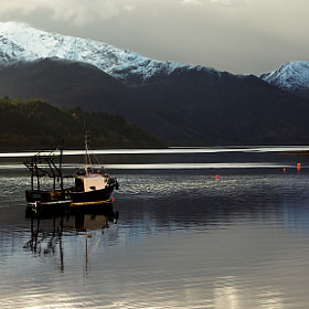 Fishing boat in Loch Leven by Paul & Mhairi Carroll (photographicview)) on 500px.com