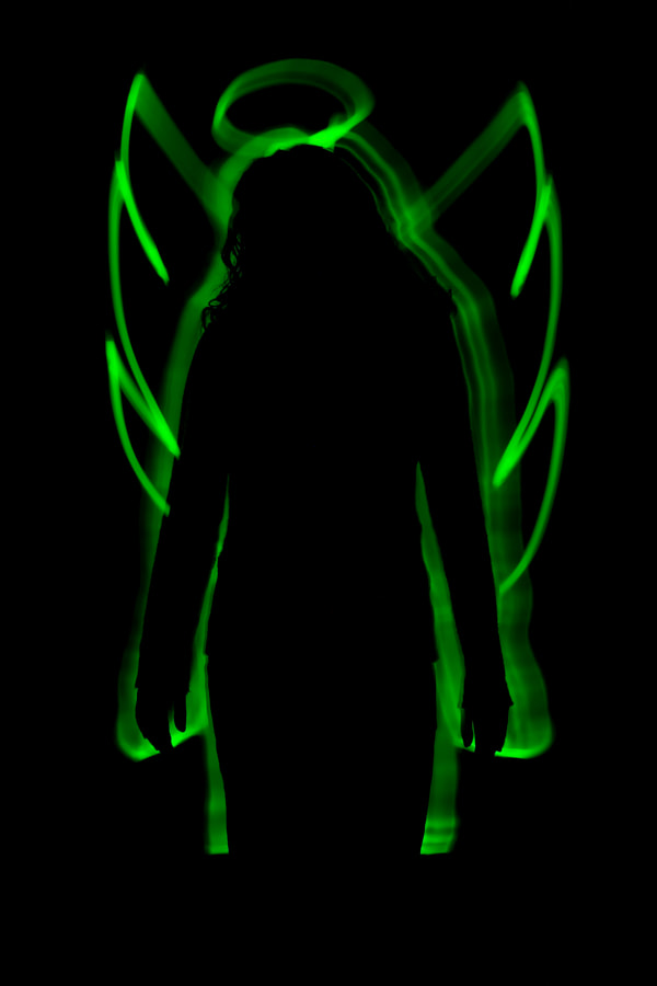 Taken in 2004. Shot using glowsticks as I stood behind the model.