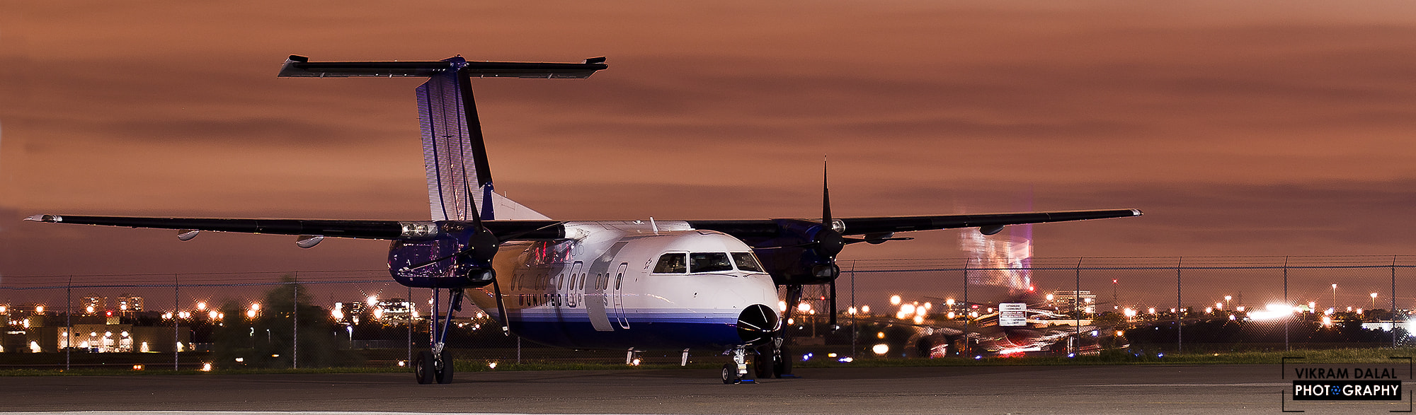 Photograph United Dash-8 with a time warping FedEx 757 by Vikram Dalal on 500px