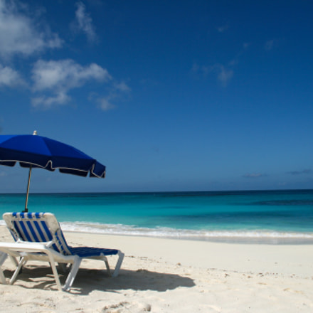 Blue umbrella and chairs on caribbean Anguilla bea