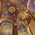 A view of the magnificent architecture, mosaics and stained glass inside the Church of All Nations, which is also known as the Basilica of the Agony.  This stunning basilica is located on the Mount of Olives outside the walls of the Old City of Jerusalem.  Right outside the basilica is the Garden of Gethsemane (גת שמנים). The mosaic on the left depicts Jesus Christ and Judas Iscariot in the garden on the night he was betrayed and arrested.