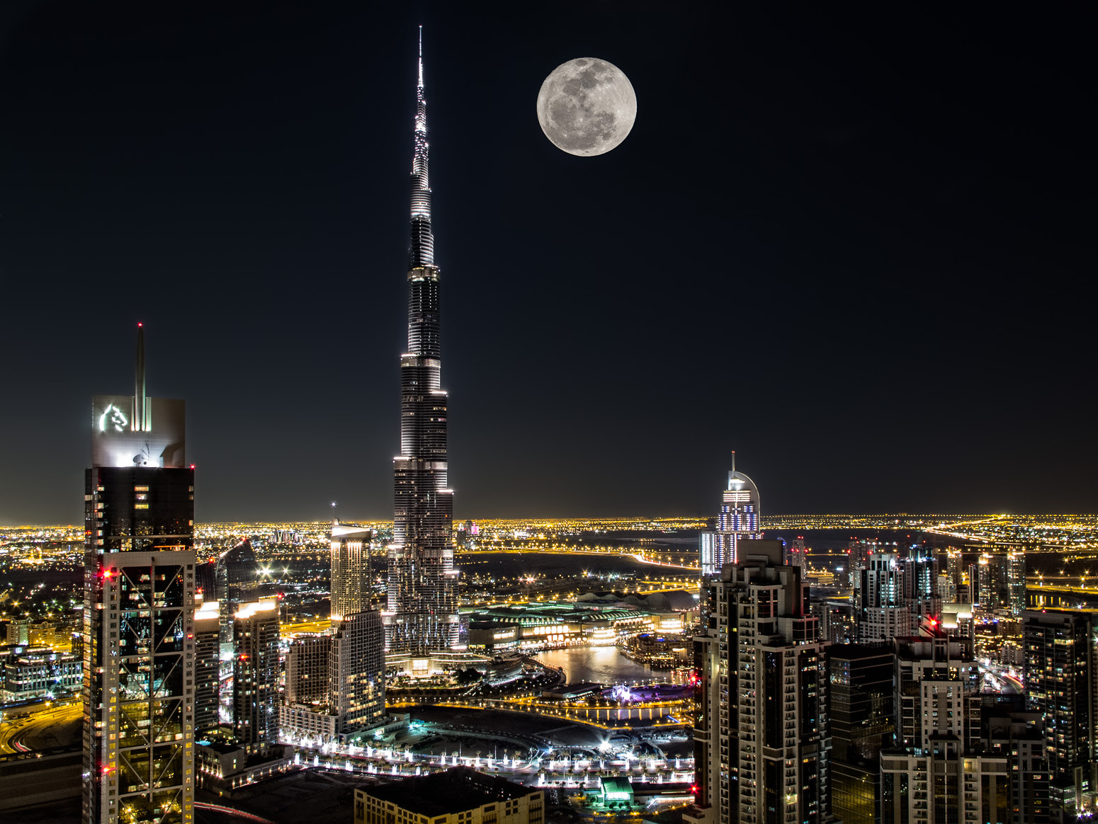 Photograph Full moon on the Burj by Giscard Matar on 500px