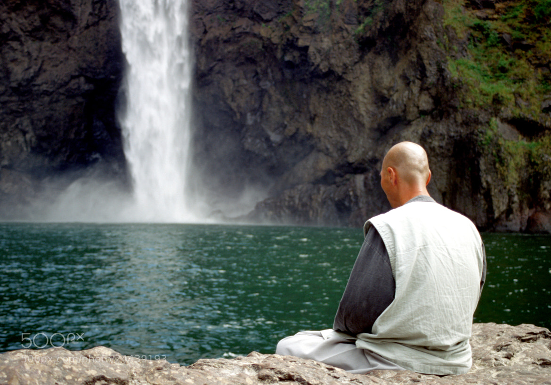 Photograph Buddhist Monk Prays by Glenn  McGloughlin on 500px