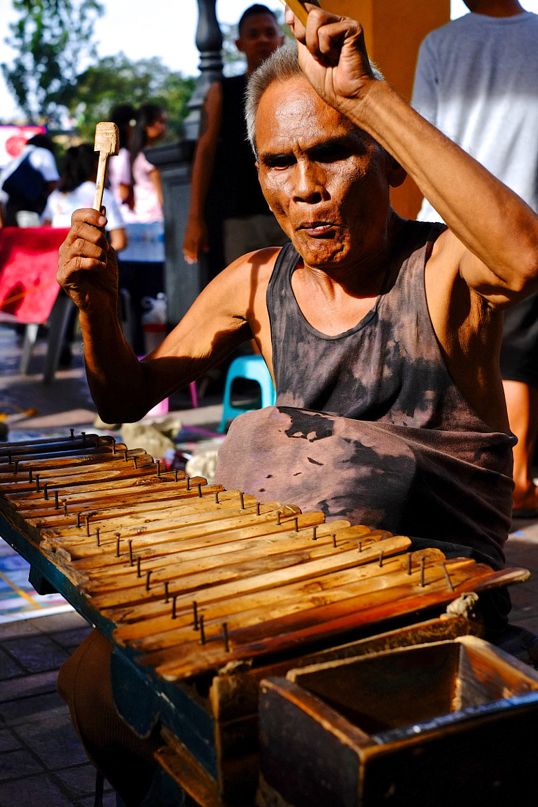 Photograph Street Musician  by Rufo Taguiam on 500px