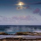 Full moon rising on Bonaire's east coast cliff.
