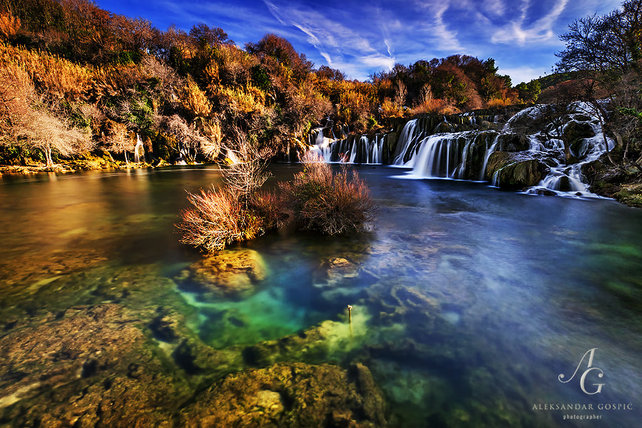 Krka river rests at the foot of the last cascade on its 73 km long journey to the Adriatic sea