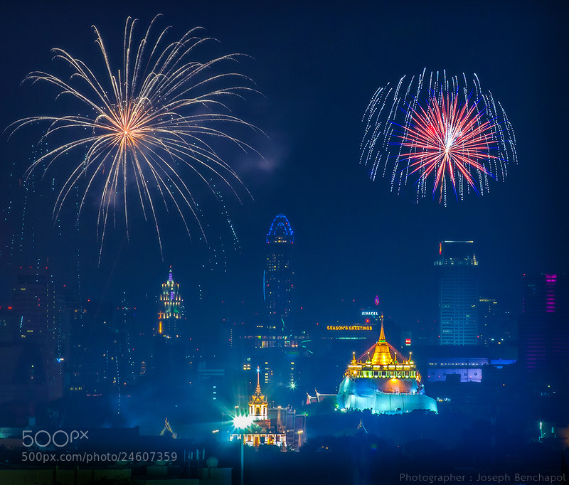 Photograph Golden Mountain and firework by Joseph Benchapol on 500px