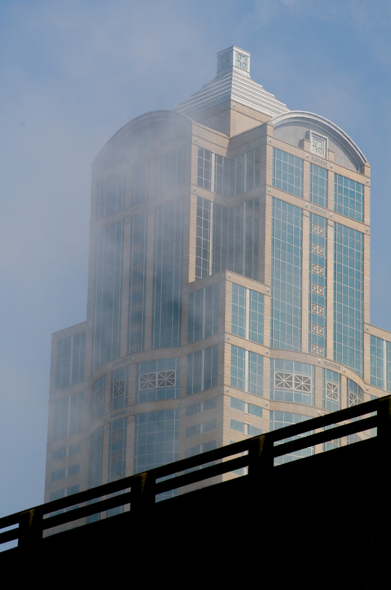 Photograph Fog Clears Seattle Building by Glenn  McGloughlin on 500px